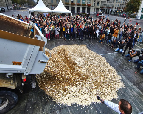 unconditional basic income - referendum in switzerland - 8 million coins dumped before parliament